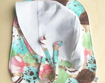 Reversible ice cream bonnet and bib set 3-6