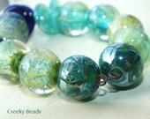 "Handmade Lampwork beads ""Couples"" Creeky Beads SRA"