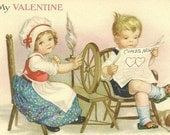 Sweetly Romantic Domestic Bliss – Vintage Valentine's Day Card – Possible Clapsaddle Image – She Spins and He Reads Cupid's News 1929