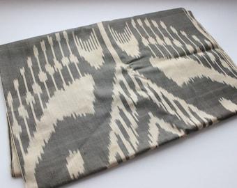 Pure silk ikat fabric. Dark grey and gold creme