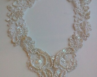 White beaded and sequin aplique for dress