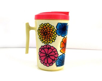 Dela plastic floral pitcher - groovy colorful bright flowers