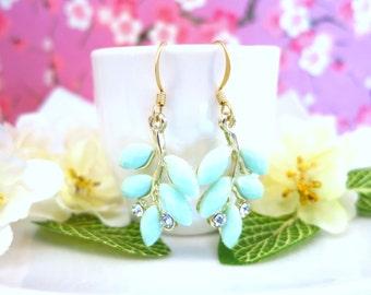 Mint green leaf chandelier gold earrings, mint green peacock fan gold dangle earrings, mint leaf nature inspired crystal chandelier earrings