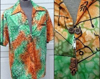 "Vintage Aloha Shirt with TIKI Toggle Zipper Front - 60s / 70s Slinky Nylon Hawaiian Petroglyph Print in Green Orange & Black 50"" Chest - L"