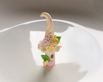 Miniature fairy house in pale pink and yellow handmade from polymer clay