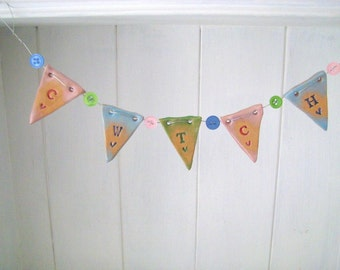 CWTCH - mini ceramic bunting with buttons. Made in Wales, UK. Pastel pink, blue, green.