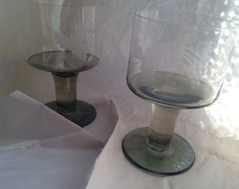 A stylish and unusual pair of green stemmed etched wine glasses