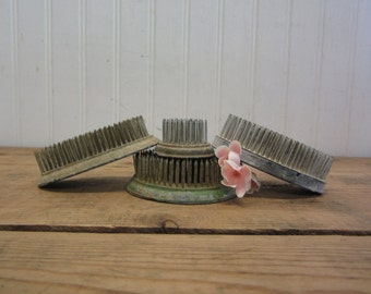 Collection of Four Vintage Metal Spiked Flower Frogs