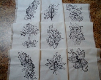machine embroidered quilt blocks  tattoo embroidery  angel wings embroidery  black tattoo design