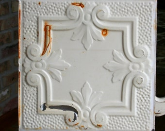 "12"" Antique Tin Ceiling Tile -- Rusty Ivory Paint -- Pretty Framed Design with Fleur De Lis"