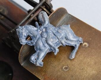 "Antique lead toy, figurine man riding a horse. ""headless horseman"""