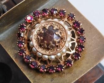 Vintage filigree brooch, with purple glass rhinestones and glass pearls