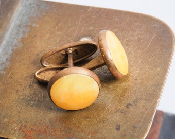 Pair of vintage metal cuff links with yellow plastic embellishment, Baltic amber imitation