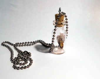 Gold dragon feather in a jar necklace