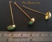 Brass ladle in 1 inch scale by Orsolya Skulteti, IGMA Fellow