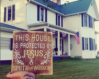 Farmhouse Sign This House Is Protected By Jesus & Smith and Wesson Gun Sign Hunter Sign Religious Sign  #downintheboondocks
