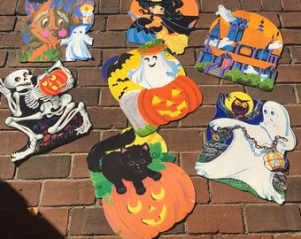 7 vintage Halloween diecuts - mostly 1960 - 1970s pumpkins, ghosts, haunted house, skeleton, black cats - sweet and not so scary