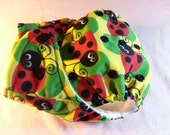 SassyCloth one size pocket diaper with ladybugs on yellow PUL print. Ready to ship.