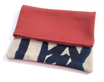 Burnt Orange and textile zipper clutch bag