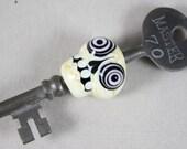 Bullseye skull on skeleton key (Item 160184)