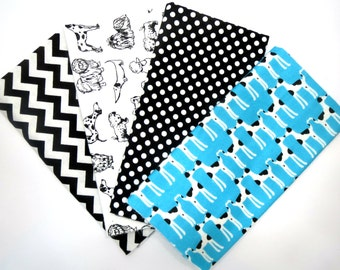 Fun Puppies,Dogs, Dots and Chevron in a 4 Pack of Flannel Fabric Fat Quarters Make up this Flannel Bundle Quilt Kit