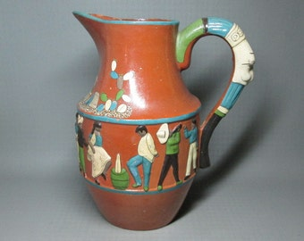 Large Tlaquepaque pottery pitcher , mexico , figures of people folk art