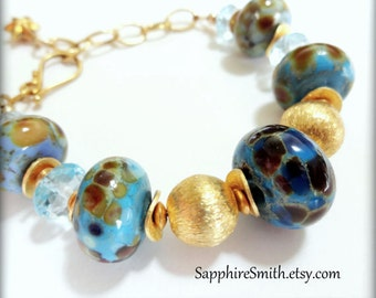 RIVER BLUES Lampwork Bracelet, Sky Blue Topaz, Artisan Lampwork Glass & Bali Gold Vermeil Bracelet, casual jewelry - 30% off