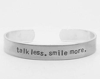 talk less. smile more: hand stamped aluminum Lin-Manuel Miranda Hamilton musical quote cuff by fandomonium