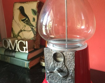 Red Carousel gumball machine. Fill with candy or marbles for interior design.