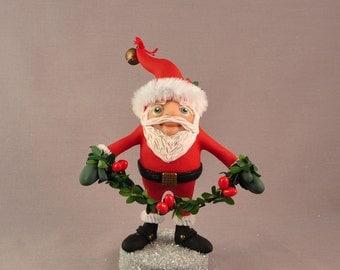 Chubby Polymer Clay Santa Figurine with a Garland