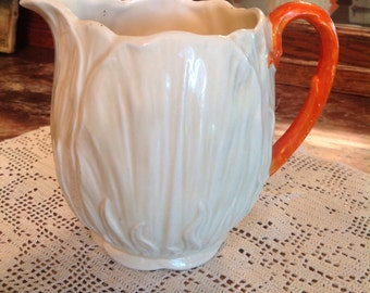 Made in England White Tulip Pitcher numbered  Orange Handle