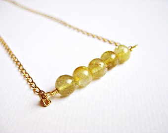 Delicate beaded necklace with gold colored quartz beads on a gold filled chain, gold specked
