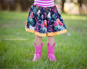 Girls  full skirt with knit waistband and ruffled hem.    Custom made sizes 12 months to 12 years.