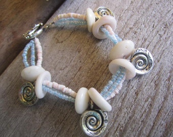 multi strand shell bracelet, puka shell bracelet, silver spiral charm bracelet, hawaii made bracelet, island jewelry