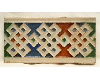 Green, orange, blue and white geometric tile