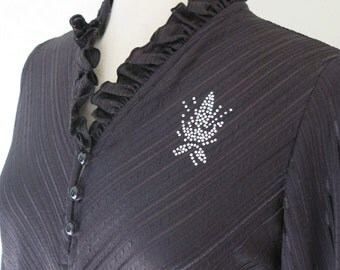 70s or 80s glam dress in black