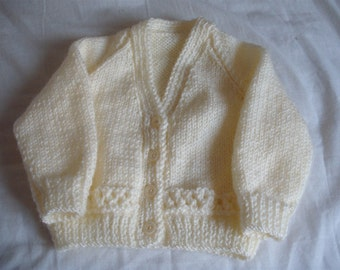 hand knitted baby cardigan 0-3 months King Cole pricewise dk wool in cream