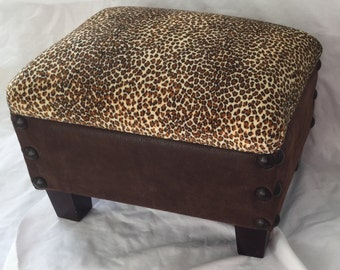 "Footstool, Ottoman.  Lepord Print Fabric on top, Microfiber Fabric on sides, Trimmed with large head tacks. 16"" X 13"" X 12"""
