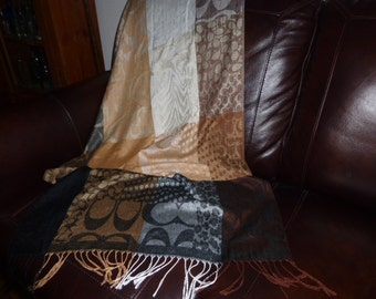 Pashmina, dark and light browns, golds, cream, beautiful and warm, with fringing. Recognize the pattern?