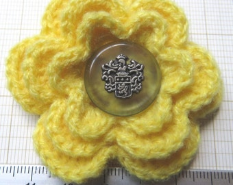 Irish crochet flower brooch in yellow wool with vintage button centre