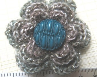 Irish crochet flower brooch in moss green and brown wool with green button centre