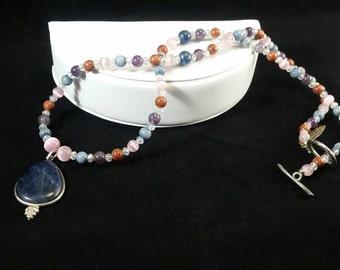 Lapis Lazuli Pendant, Sunstone, Amethyst, Cat eye, and Swarvski crystals