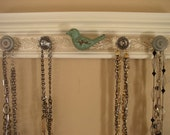 Jewelry organizer. This  wall rack  necklace hanger features a bird center  & 5 knobs total on off  white finished 15 inches long