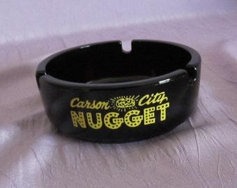 Vintage Casino Ashtray Carson City Nugget Black Glass Yellow Lettering