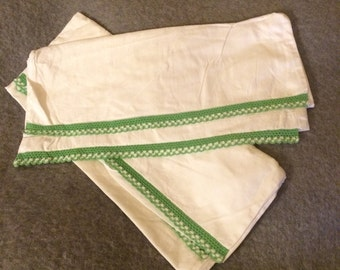 Pair of unused white thick cotton pillow slips with green and white crochet trim. 1950's