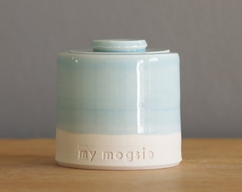 custom urn with lid. Handmade pottery pet urn or human ashes urn. White porcelain, light blue.