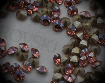 Xilion 1028 20pp Genuine Swarovski Crystals Light Rose Champagne Rounds Foiled Rhinestones 144pcs 1 Gross