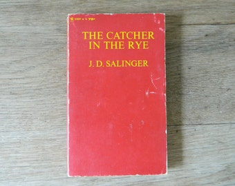 The Catcher in the Rye by J.D. Salinger. vintage paperback. 1965 printing.
