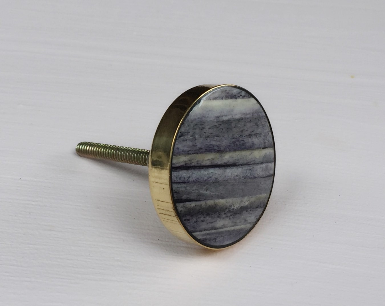 grey and brass bone cabinet knob