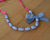 Grey and cherry red paper bead necklace on satin ribbon